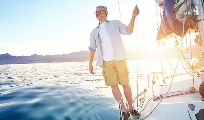 Older man on sail boat